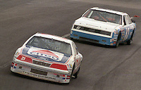 Kyle Petty 21 Ford Randy Baker 87 Oldsmobile action during the Southern 500 at Darlington Raceway in Darlington, SC in September 1988. (Photo by Brian Cleary/www.bcpix.com)