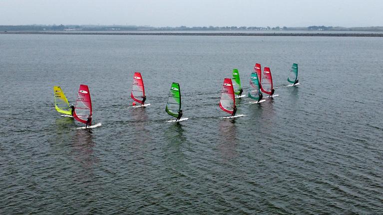 A group of the Kona windsurfers on a windward leg in 15 to 20 knot south easterly breeze on Malahide Estuary