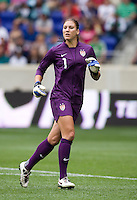 Hope Solo (1) of the USWNT  runs backwards as she keeps track of the action during the game at Red Bull Arena in Harrison, NJ.  The USWNT defeated Mexico, 1-0.