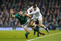 Saturday 2nd February 2019 | Ireland vs England<br /> <br /> Robbie Henshaw tackles Jonny May during the opening Guinness 6 Nations clash between Ireland and England at the Aviva Stadium, Lansdowne Road, Dublin, Ireland.  Photo by John Dickson / DICKSONDIGITAL