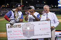 (L-R) Chris Marrero of the Pawtucket Red Sox, NFL wide receiver Steve Smith Sr., and Charlotte Knights Chief Operatin Officer Dan Rajkowski share a laugh as they present a check to the Steve Smith Foundation in honor of Marrero winning the 29th Annual Triple-A Home Run Derby at BB&T BallPark on July 11, 2016 in Charlotte, North Carolina.   (Brian Westerholt/Four Seam Images)