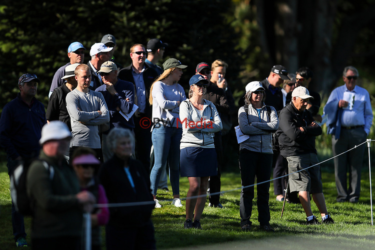 Spectators follow local boy Daniel Hillier of New Zealand during the Asia Pacific Amateur Golf Championship Round Two, Royal Wellington Golf Course, Wellington, New Zealand, 27 October2017.  Photo: Simon Watts/www.bwmedia.co.nz