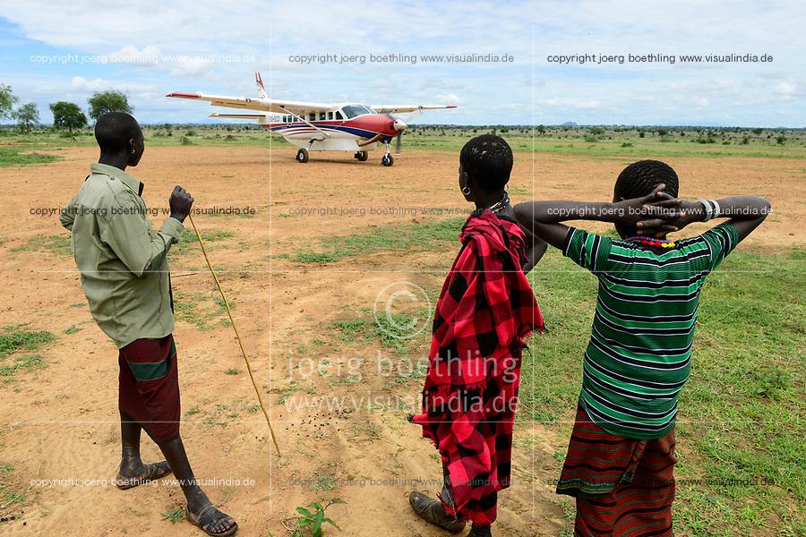 UGANDA, Karamoja, Kotido, MAF Mission Aviation Fellowship, airplane at bush airstrip, Karamojong tribe, flight service for missionaries, NGO and relief goods