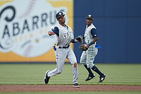 Columbia Fireflies shortstop Maikel Garcia (8) makes a throw to first base against the Kannapolis Cannon Ballers at Atrium Health Ballpark on May 18, 2021 in Kannapolis, North Carolina. (Brian Westerholt/Four Seam Images)