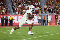 LOS ANGELES, CA - SEPTEMBER 11: Nathaniel Peat #8 of the Stanford Cardinal runs with the ball on a kickoff return during a game between University of Southern California and Stanford Football at Los Angeles Memorial Coliseum on September 11, 2021 in Los Angeles, California.