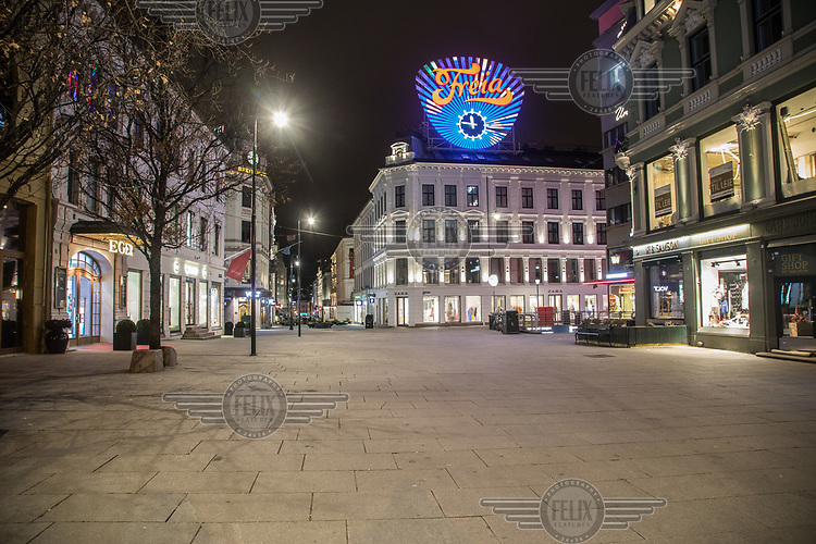 Near midnight in Karl Johan st., the main street in Oslo.  Like most capitals, Oslo is usually busy on a Saturday night. But on the first weekend after Norwegian authorites  introduced measures to combat the Coronavirus (COVID-19) the city was almost deserted. <br /> <br /> Restriction on public gatherings, closure of schhols, new rules for those serving food and drinks, and fear of further spread of the virus compelled most bars and restaurants to close. Between 9 and midnight, normally a thriving time in the city centre, hardly any people ventures out. <br /> <br /> ©Fredrik Naumann/Felix Features