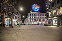 Near midnight in Karl Johan st., the main street in Oslo.  Like most capitals, Oslo is usually busy on a Saturday night. But on the first weekend after Norwegian authorites  introduced measures to combat the Coronavirus (COVID-19) the city was almost deserted. <br />
