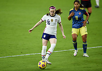 ORLANDO, FL - JANUARY 18: Rose Lavelle #16 of the United States passes off the ball during a game between Colombia and USWNT at Exploria Stadium on January 18, 2021 in Orlando, Florida.