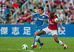 Vassirkiri Abou Diaby of Arsenal FC and Jordi Tarres of Kitchee in action during the pre-season Asian Tour friendly match at the Hong Kong Stadium on July 29, 2012. Photo by Victor Fraile / The Power of Sport Images