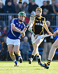 Sean Collins of Cratloe in action against Brian Carrig of  Ballyea during the county senior hurling final at Cusack Park. Photograph by John Kelly.