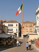 Flag of Italy flying from pole in piazza in Chioggia Ital