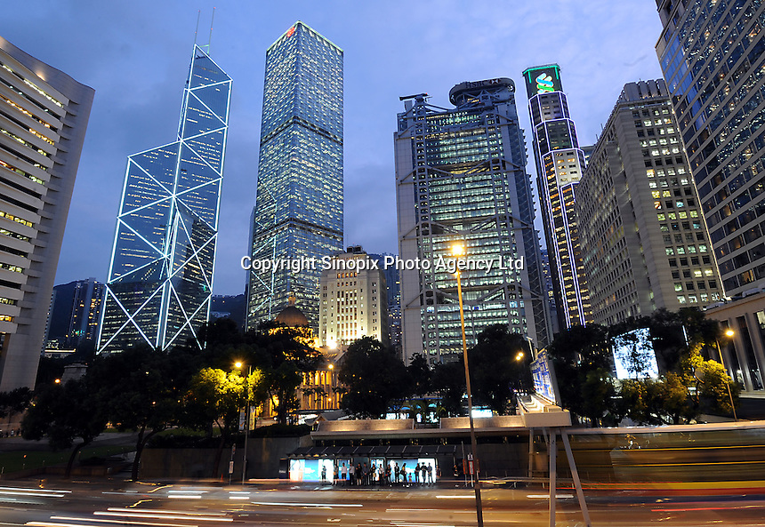 Hong Kong Central District with the skyscrapers, from left, Bank of China (pointed) , Cheung Kong Center, HSBC Bank Headquarters and the Standard and Chartered Bank, with Chater Garden and the Hong Kong Legislative Council in the foreground................