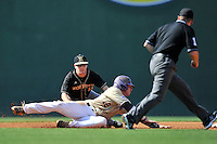Shortstop Derek Hirsch (11) of the Wofford Terriers tries to tag Bryson Bowman in a SoCon Tournament game against Western Carolina on Wednesday, May 25, 2016, at Fluor Field at the West End in Greenville, South Carolina. Western won, 10-9. (Tom Priddy/Four Seam Images)