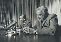 After a fruitful discussion, Quebec Premier Robert Bourassa and Premier John Robarts of Ontario smile as they speak to a press conference at Queen's Park yesterday, joining in plea to Ottawa on unemployment problems.<br /> <br /> 1970<br /> <br /> PHOTO :  Dick Darrell - Toronto Star Archives - AQP