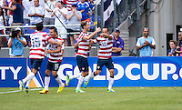 Landon Donovan, Clarence Goodson.  The United States defeated El Salvador, 5-1, during the quarterfinals of the CONCACAF Gold Cup at M&T Bank Stadium in Baltimore, MD.