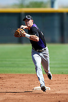 Colorado Rockies minor league infielder Trevor Story #10 during an instructional league game against the San Francisco Giants at the Salt River Flats Complex on October 4, 2012 in Scottsdale, Arizona.  (Mike Janes/Four Seam Images)