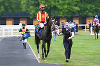 Winner of The Crouch's Down Maiden Auction Fillies Stakes Crazy Luck ridden by Oisin Murphy and trained by Rod Millman is led into the Winners enclosure during Horse Racing at Salisbury Racecourse on 13th August 2020