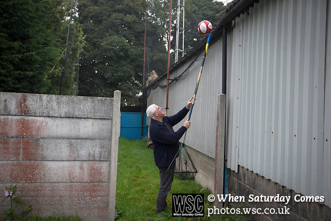 Ramsbottom United 1 Barwell 3, 03/10/2015. Riverside Stadium, Northern Premier League. The home club's vice-chairman Chris Woolfall, retrieving a match balls from behind a stand at the Harry Williams Riverside Stadium, home to Ramsbottom United as they played Barwell in a Northern Premier League premier division match. This was the club's 13th league game of the season and they were still to record their first victory following a 3-1 defeat, watched by a crowd of 176. Rams bottom United were formed by Harry Williams, the current chairman, in 1966 and progressed from local amateur football  in Bury to the semi-professional leagues. Photo by Colin McPherson.