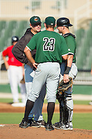Augusta GreenJackets pitching coach Steve Kline (left) has a chat on the mound with starting pitcher Christian Jones (23) and catcher Tyler Ross (26) during the game against the Kannapolis Intimidators at CMC-NorthEast Stadium on August 3, 2014 in Kannapolis, North Carolina.  The Intimidators defeated the GreenJackets 10-5. (Brian Westerholt/Four Seam Images)