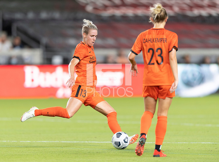 HOUSTON, TX - SEPTEMBER 10: Sophie Schmidt #13 of the Houston Dash clears the ball from her side of the field during a game between Chicago Red Stars and Houston Dash at BBVA Stadium on September 10, 2021 in Houston, Texas.