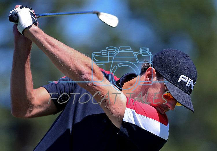 Olympic gold medalist Michael Phelps hits on the driving range before a practice round in the American Century Celeb-Am Tournament at Edgewood Tahoe in Stateline, Nev., on Thursday, July 18, 2013.<br /> Photo by Cathleen Allison