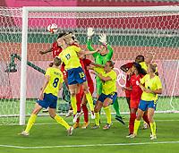 YOKOHAMA, JAPAN - AUGUST 6: Amanda Ilestedt #13 of Sweden heads the ball away from Stephanie Labbe #1 of Canada during a game between Canada and Sweden at International Stadium Yokohama on August 6, 2021 in Yokohama, Japan.