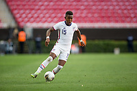 ZAPOPAN, MEXICO - MARCH 21: Andres Perea #15 of the United States turns with the ball during a game between Dominican Republic and USMNT U-23 at Estadio Akron on March 21, 2021 in Zapopan, Mexico.