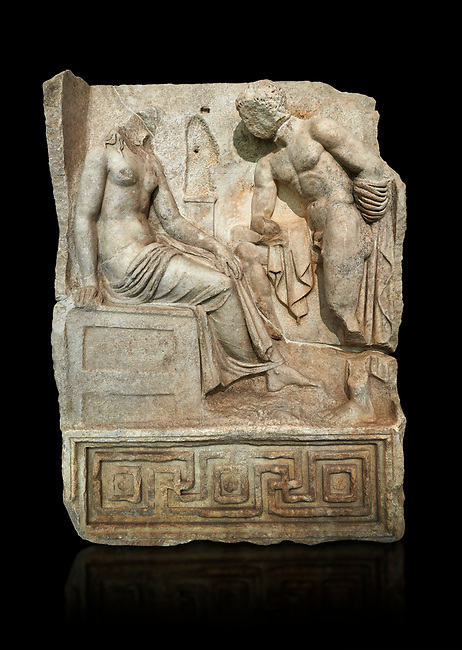 "Roman Sebasteion relief  sculpture of Io and Argos Aphrodisias Museum, Aphrodisias, Turkey.   Against a black background.<br /> <br /> A powerful hero is folding a sword gazing closely at a half naked and dishevelled young heroine who sits on a chest like stool. Between, on a pillar base stood a small, separately added statue of a goddess ( now missing). The scene follows a scheme used in the relief panels ""Io guarded by Argos"". Io was one of Zeus's lovers, and Argos was a watchful giant sent to guard her by Hera, Zeus's wife."