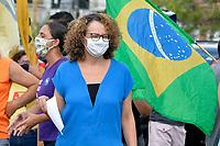 PORTO ALEGRE, RS, 23/01/2021 - ATO - FORA BOLSONARO - A deputada estadual Luciana Genro (PSOL/RS), durante ato de Movimentos Sociais, populares, representantes de partidos políticos de oposição ao governo e entidades sindicais realizaram carreata em defesa da vacinação de toda a população brasileira contra a Covid-19 e o Impeachment do presidente da República Jair Bolsonaro (sem partido), do Largo Zumbi dos Palmares para as principais ruas, em Porto Alegre, neste sábado (23).