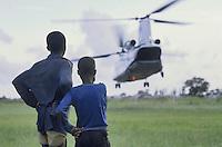 - two children watch an Italian CH 47 Chinook military helicopter of UN peace mission  ....- due bambini guardano un elicottero militare italiano CH 47 Chinook della missione di pace ONU