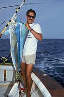 Charlie Murray with 25 lb 4 oz. mahi mahi, dorado or dolphin fish,Coryphaena hippurus, Cayman Angling Club Tournament Grand Cayman, British West Indies (Caribbean Sea)