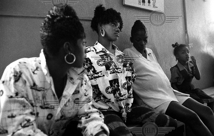 Young mothers wait at a pregnancy clinic that forms part of the S Corner Project, set up in a deprived area of Kingston.