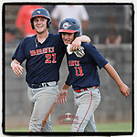 Collin Fowler (21), left, and Brody Fahr (11) of the Greer Warhawks celebrate scoring runs in the same play in a South Carolina American League game against Easley on Tuesday, July 14, 2020, at Stevens Field in Greer, South Carolina. Greer won, 18-1. (Tom Priddy/Four Seam Images)