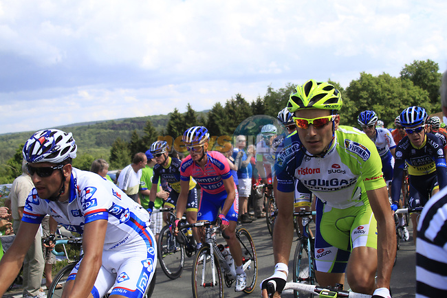 The peloton including Ivan Basso (ITA) Liquigas-Cannondale climbs the Cote De Barvaux during Stage 1 of the 99th edition of the Tour de France, running 198km from Liege to Seraing, Belgium. 1st July 2012.<br /> (Photo by Eoin Clarke/NEWSFILE)