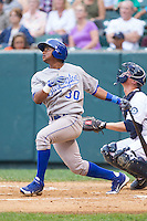 Christian Cano (30) of the Burlington Royals follows through on his swing against the Pulaski Mariners at Calfee Park on June 20, 2014 in Pulaski, Virginia.  The Mariners defeated the Royals 6-4. (Brian Westerholt/Four Seam Images)