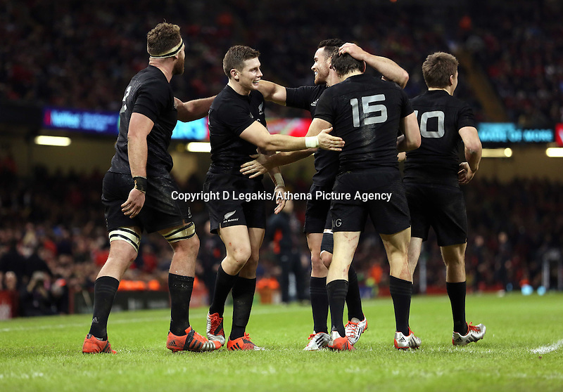 Pictured: Beauden Barrett of New Zealand (2nd L) with team mates celebrating his try Saturday 22 November 2014<br /> Re: Dove Men Series 2014 rugby, Wales v New Zealand at the Millennium Stadium, Cardiff, south Wales, UK.