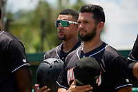 Jupiter Hammerheads Victor Victor Mesa (32) and Michael Hernandez (right) during the national anthem before a Florida State League game against the Dunedin Blue Jays on May 16, 2019 at Jack Russell Memorial Stadium in Clearwater, Florida.  Dunedin defeated Jupiter 1-0.  (Mike Janes/Four Seam Images)