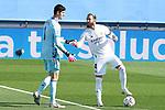 Real Madrid's Thibaut Courtois (l) and Sergio Ramos during La Liga match. October 31, 2020. (ALTERPHOTOS/Acero)
