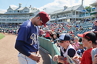 Frisco RoughRiders Walker Weickel (38) signs autographs before a Texas League game against the Springfield Cardinals on May 5, 2019 at Dr Pepper Ballpark in Frisco, Texas.  (Mike Augustin/Four Seam Images)