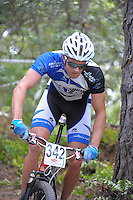 Rory Mead in action during the first round of the 2014 New Zealand National Cross-country Mountainbiking Championships at Mount Victoria, Wellington, New Zealand on Sunday, 19 January 2014. Photo: Dave Lintott / lintottphoto.co.nz