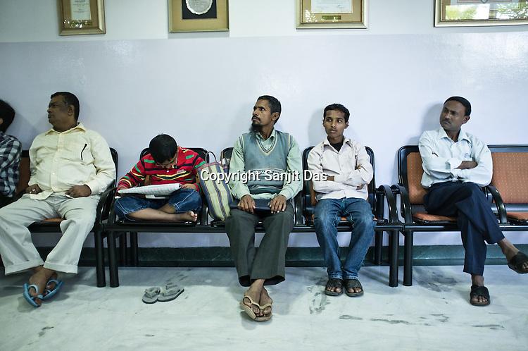 Patients wait outside the office of the heart surgeon Dr. Devi Prasad Shetty at the Narayana Hrudayalaya in Bangalore, Karnataka, India. Photo: Sanjit Das/Panos