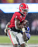 ATHENS, GA - OCTOBER 19: George Pickens #1 of the Georgia Bulldogs is tackled by Yusuf Corker #29 of the Kentucky Wildcats after a reception during a game between University of Kentucky Wildcats and University of Georgia Bulldogs at Sanford Stadium on October 19, 2019 in Athens, Georgia.