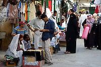 Tripoli, Libya - Medina Street Scene, Man Shopping for Jewelry, Woman in Veil