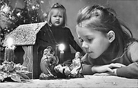 1970 FILE PHOTO -<br /> <br /> Christmas 1970-it's a child's world. Christmas is the time of year when the angels sing and people forget - for a little while anyway- the trouble in their lives. But the spirit of Christmas lives best in the hearts of children. Star photographer Boris Spremo took this picture as his daughter Linda; 8; and Sandra; 5; were caught up in the wonder of the Nativity scene. It's this simple aspect of the Christmas celebration that nothing is able to destroy.