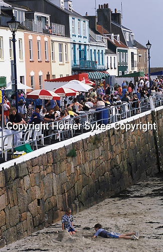 Gorey Jersey The Channel islands. Evening tourists on the quayside  pubs and bards .2000s