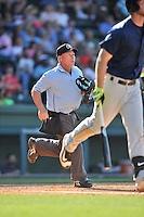 Home plate umpire Brian Durham works a game between the Greenville Drive and Columbia Fireflies on Sunday, May 8, 2016, at Fluor Field at the West End in Greenville, South Carolina. Greenville won, 5-4. (Tom Priddy/Four Seam Images)