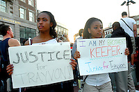 Description/Caption:<br /> Hundreds rally in Harvard Square Cambridge MA demanding justice for murdered hoodie wearing Sanford Florida teenager Trayvon Martin and protesting justified homicide laws that protect alleged murderers like George Zimmerman 3.22.12