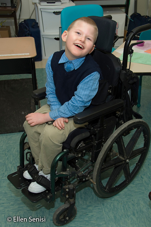MR / Albany, NY.Langan School at Center for Disability Services .Ungraded private school which serves individuals with multiple disabilities.Portrait of child sitting in a wheelchair. Boy: 9, cerebral palsy, non verbal with expressive and receptive language delays.MR: Law4.© Ellen B. Senisi