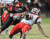 10/07/11 - Fullerton Ca. ; Savanna QB #10 Johnathan Thomas is sacked in the third quarter by Troy linebacker #44 Nathan Fleming.