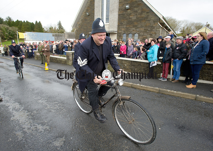 The arrival of the RIC men during the re-enacting an incident involving the disarming of three RIC officers, which took place in 1919 at Knockerra village as part of their Easter commemoration. Photograph by John Kelly.